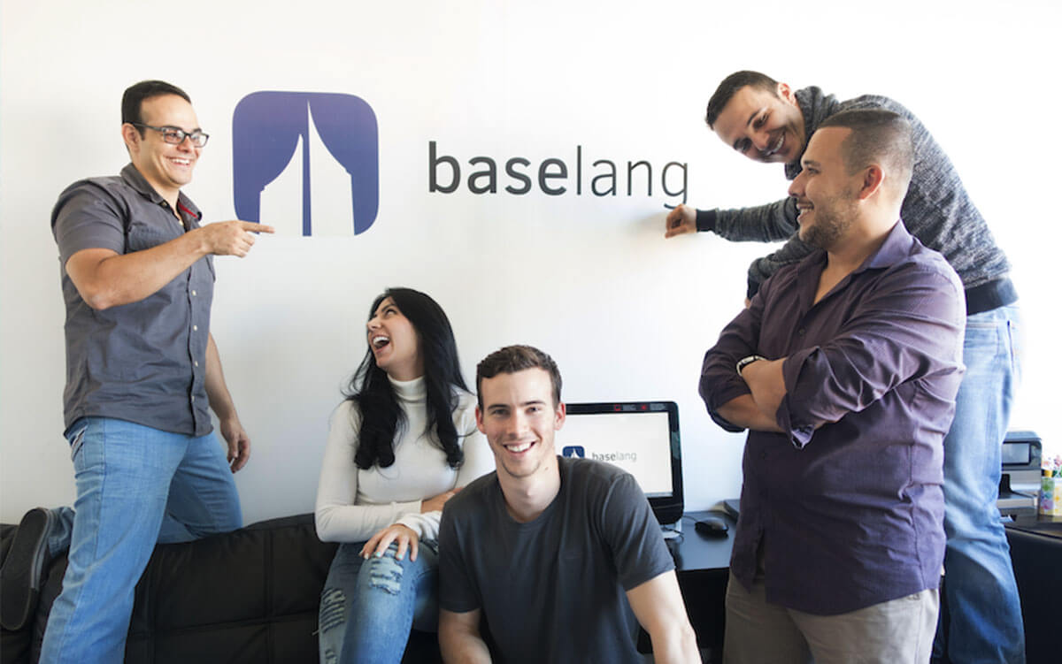 people gathering around the Baselang logo